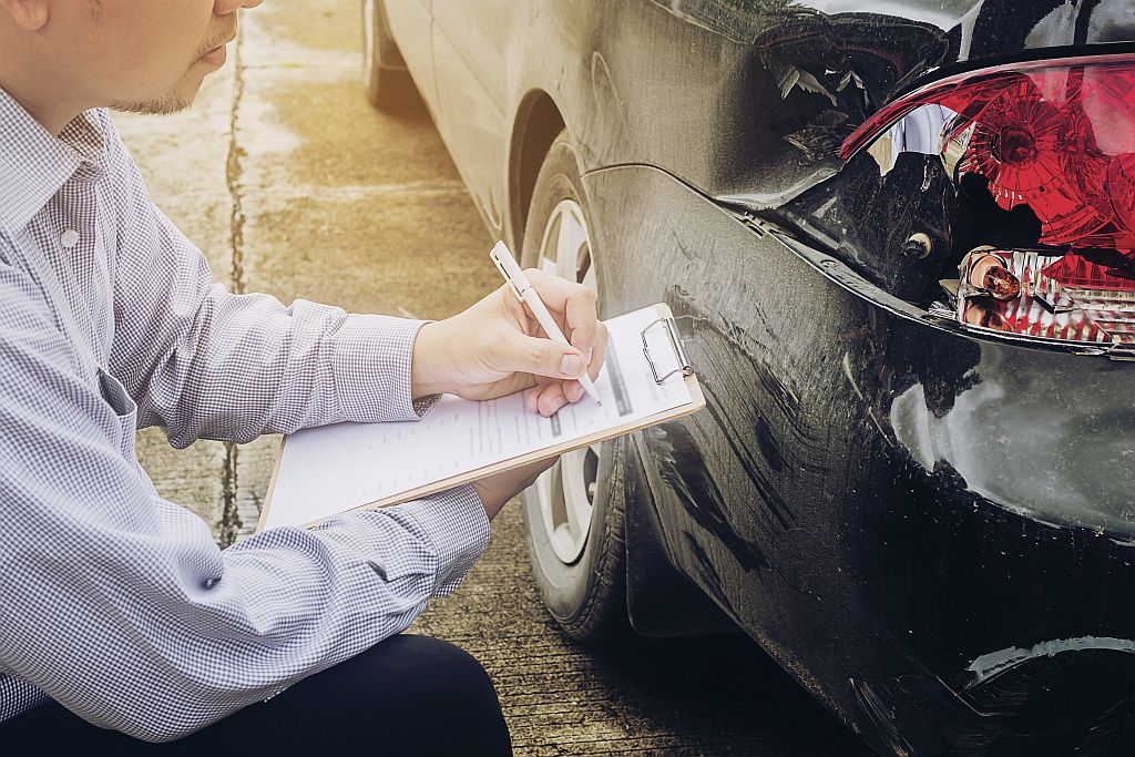 Insurance agent working on car accident claim process